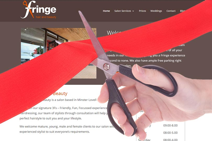 A ribbon is cut over an image of the new Fringe Hair & Beauty website